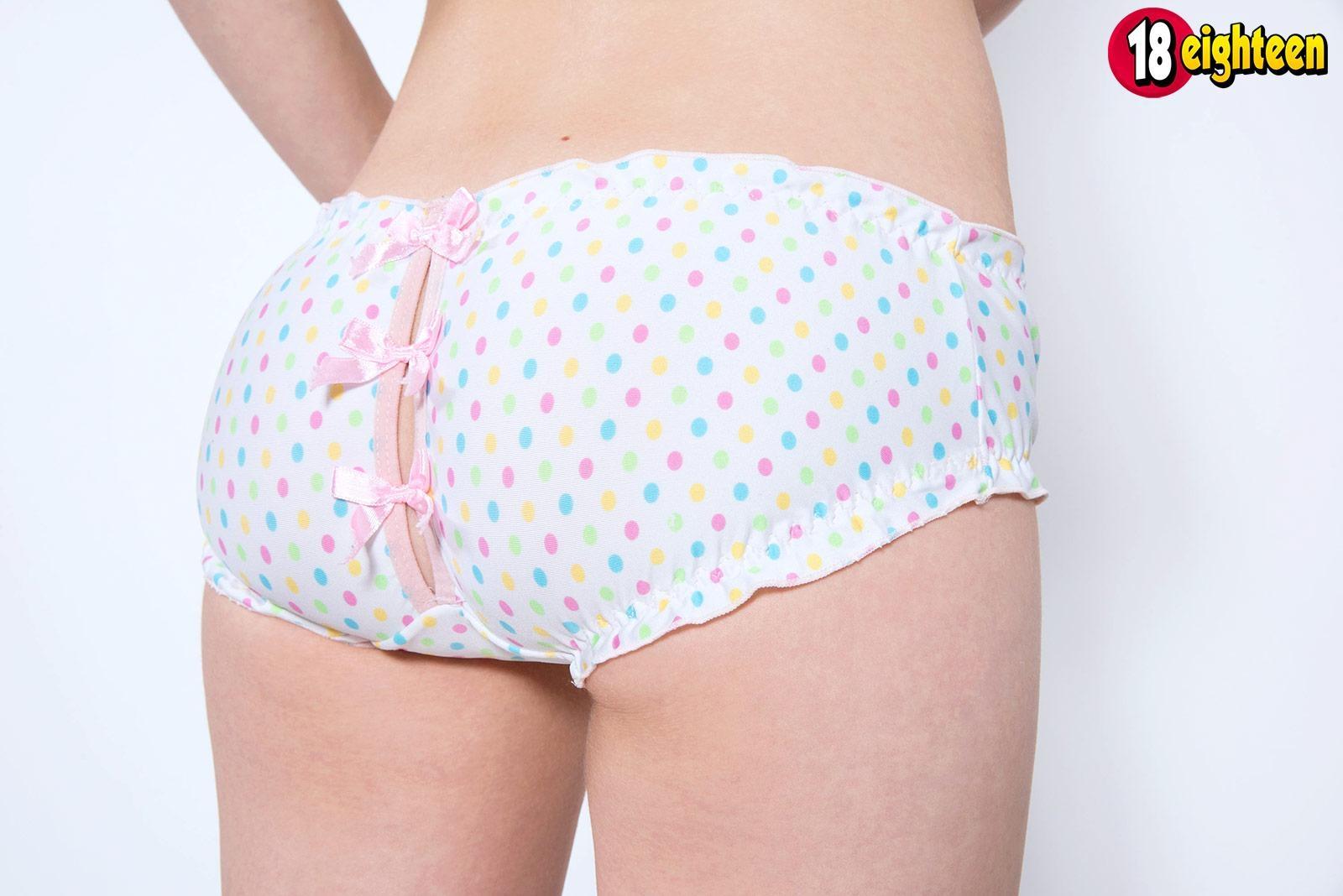 Redheaded teen pornstar Dolly Little exposing small breasts in cute panties
