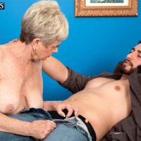 Short haired granny Lin Boyde revealing large tits before giving handjob and BJ