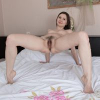 Stocking clad European amateur Slava Sanina spreading hairy pussy in high heels