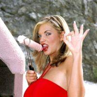 Blonde European pornstar Ines Cudna releasing massive boobs from dress outdoors