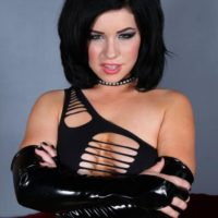 Brunette Domme Belle Noir showing off nice and shaved cunt in black latex boots