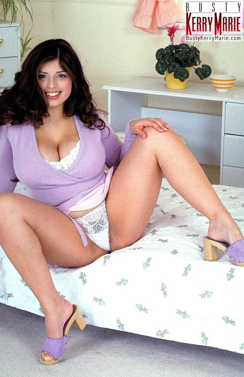 Chubby brunette pornstar Kerry Marie releasing huge MILF boobs from lingerie