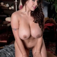 Chunky brunette solo girl Sheridan Love unveiling massive tits and hairy pussy