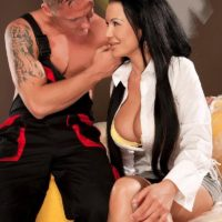 Dark haired babe Patty Michova having big tits freed before licking large cock