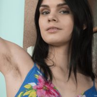 Dark haired Euro amateur Gerda May showing off furry armpits and hairy vagina