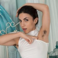 European brunette Luna displaying hairy underarms and beaver in ballerina outfit