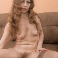 European solo girl Elza displaying hairy cunt while rolling off tan stockings