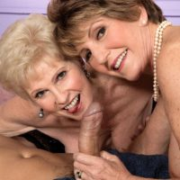 Horny grannies Bea Cummins and Jewel tongue kiss and give large dick double BJ