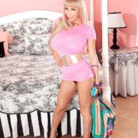 Leggy blonde MILF Venera releasing huge knockers from sheer black lingerie