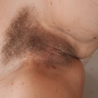 Leggy Euro amateur Abigail baring saggy boobs before freeing hairy cunt from panties
