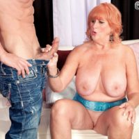 Leggy redhead granny Jackie having big tits sucked before giving big dick oral sex
