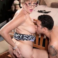 Mature blonde lady Tracy Licks having big tits freed before giving handjob and BJ