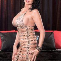 Mature brunette pornstar Rita Daniels flashing no panty upskirt during tit sucking