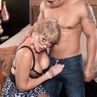 Over 50 blonde MILF Tracy Licks having big tits exposed before giving BJ in glasses