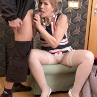 Over 50 cougar Georgina giving bike courier oral sex in white stockings and heels