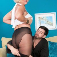 Pantyhose and skirt attired grandma Jeannie Lou blowing big cock on knees