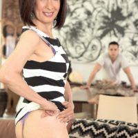 Petite Asian granny Kim Anh stripping down to silk lingerie and thong panty set