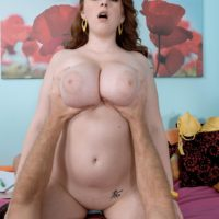 Redhead model Felicia Clover unveiling massive juggs and big butt before sex