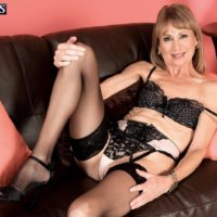 Stocking and lingerie attired granny Patsy crossing and uncrossing legs in high heels