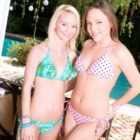 Teen lesbians Sammy Daniels and Aubrey Star peel off each others bikini outdoors