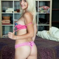 Young blonde amateur Stacy Kiss stripping off jeans and pink bra and panty set