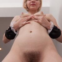 Young Euro blonde Baibira freeing hairy pussy from maid uniform in high heels