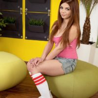Young redhead amateur Loreen flashing panties after slipping off shorts in knee socks