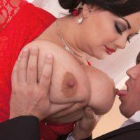 Brunette BBW Nila Mason unleashing massive tits before giving BJ in stockings