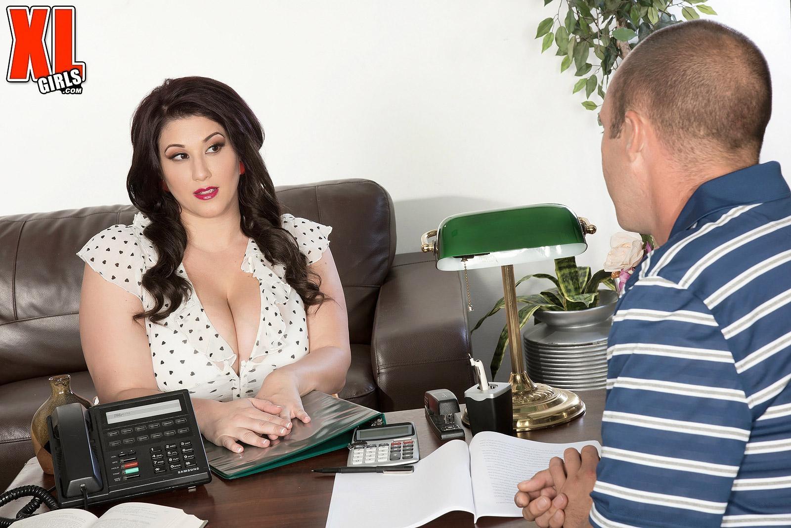 Brunette BBW pornstar Angel DeLuca having huge boobs exposed in office