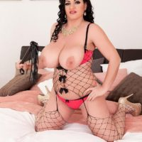 Brunette solo girl Juliana Simms unleashing massive all natural hooters from lingerie