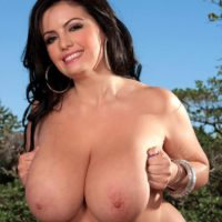 Chubby brunette MILF Arianna Sinn flaunting huge tits and nipples outdoors in heels