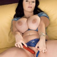Dark haired BBW Denisa loosing huge boobs from bra before masturbating pussy