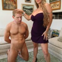 High heel attired mistress Holly Halston having collared sissy eat out pussy