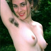 Hirsute European amateurs with big natural tits exposing hairy cunts outdoors