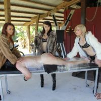 Isobel Raven and gfs humiliate and cane restrained male sub on bondage table