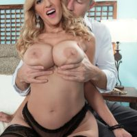 Sexy blonde MILF Holly Claus having big tits exposed before sucking off huge cock