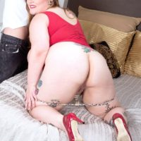 Tattooed BBW Busty Emma exposing huge boobs and ass before giving handjob