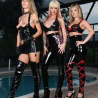 3 hot chicks in latex outfits and high heels debase hooded male slave by pool