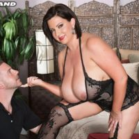 Big boobed brunette Paige Turner giving handjob after nipple sucking in stockings