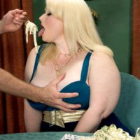 Blonde BBW pornstar Dawn Davenport jerking cock while eating food and masturbating