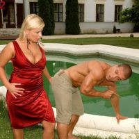 Blonde MILF Lucy Love freeing big boobs for tit sucking from black man by pool