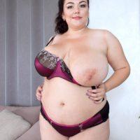 Brunette BBW Mariya Mills letting huge floppy tits free from dress and bra in nylons