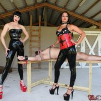 Brunette Dommes Jean Bardot and Michelle Lacy dominate man on bondage table