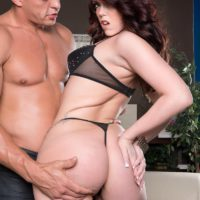 Brunette MILF Ryan Smiles showing off big ass in thong panties and high heels