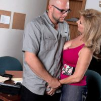 Busty blonde cougar Laura Layne seducing mechanics for MMF threesome in garage