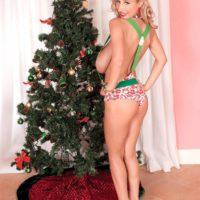 Busty blonde MILF Venera showing off great legs in high heels by Christmas tree