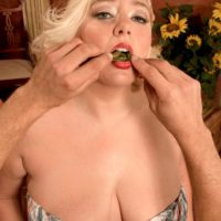 Chubby blonde girl Daphne Carter letting big tits loose while eating food and giving BJ