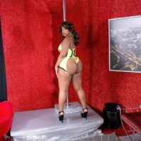 Chunky black stripper Layla Monroe showing off big booty in black high heeled shoes