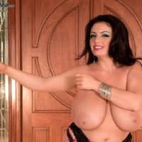 Curvy brunette MILF Arianna Sinn letting massive tits loose from bra in nylons