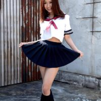 Cute Asian solo girl Ria Sakuragi letting huge natural tits loose from sailor uniform